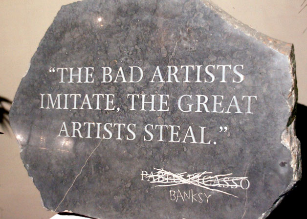 "Image of engraved marble with quotation ""The Bad Artists Imitate, The Great Artists Steal"" engraved in marble and the signature ""Pablo Picasso"" scratched out and ""Banksy"" scratched in beneath."