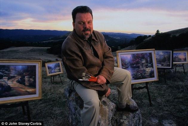 photograph of Thomas Kinkade with paintings