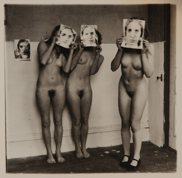 Terri Ray, Liz Tarnov & Vaneeesa Blaylock, HKAPA dance students standing naked in a room and holding photo prints of Terri Ray in front of their faces