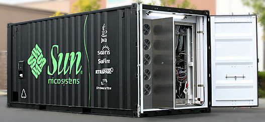 A cargo container with Sun logos on the outside and the door open to show the server farm inside