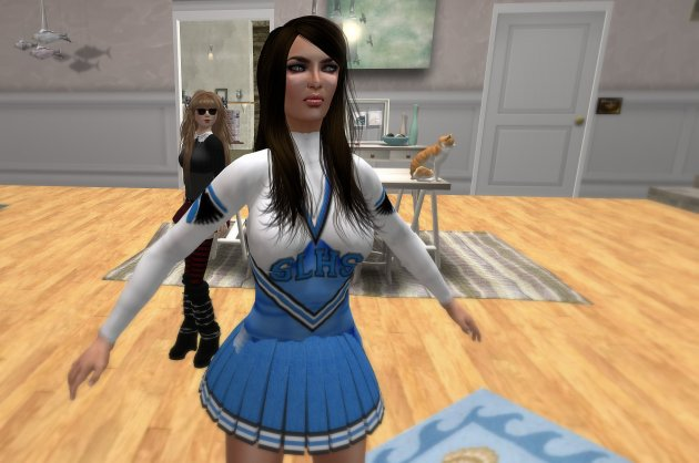 Liz Bowman & Adriana Princess at Princess home where she models SLHS uniform design for Liz