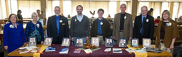 Group of authors behind a table