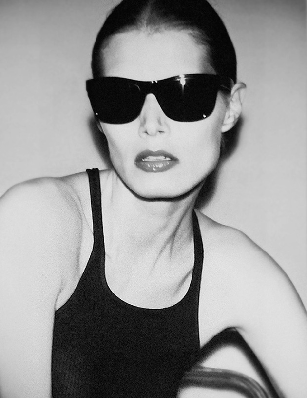 Black and white photo of Vaneeesa Blaylock in black tank top and black Ray-Bans. Taipei 1991