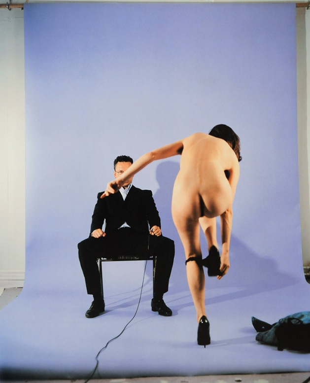 Vaneeesa Blaylock, The Hague, 1997, back to camera, doing formalized striptease in front of male faculty member