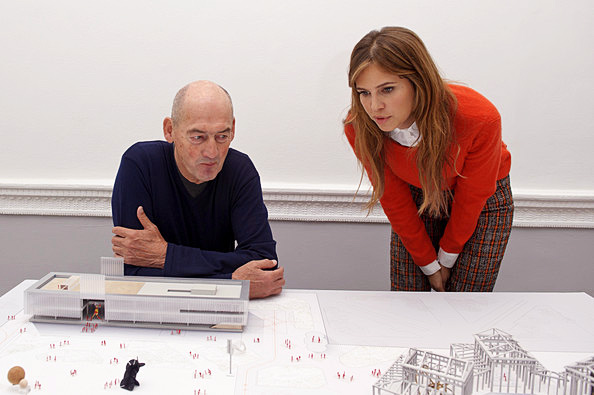 Gregory Horne and Vaneeesa Blaylock looking at project models on a table, Halliburton, The Hague, 2001