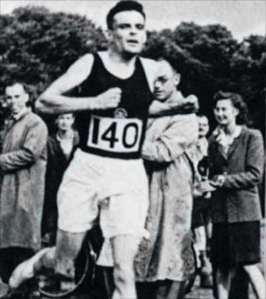 Image of Alan Turing running in shorts and tank top, with number 140 pinned to the front of his shirt