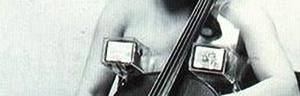 "detail image of Charlotte Moorman wearing her legendary ""TV Bra"""
