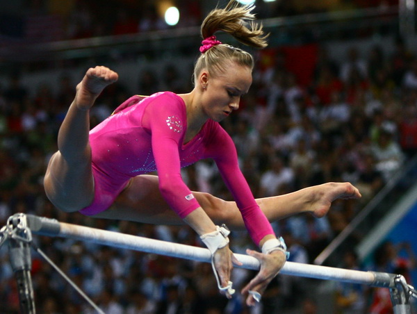 Image of Nastia Liukin on uneven parallel bars at 2008 Olympic Games in Beijing