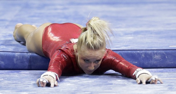 Nastia Liukin on gymnastic mat after falling from uneven parallel bars at 2012 Olympic trials in San Jose, CA