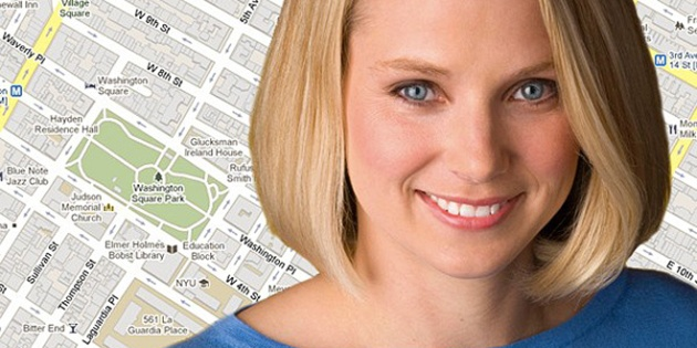 Image of Marissa Mayer in front of a map