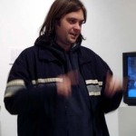 Nathan Shafer's Kickstarter icon, a waist length image of him gesturing while speaking and wearing a black jacket