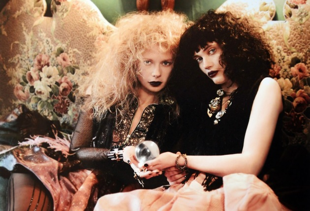 "Fiona Blaylock & Vaneeesa Blaylock in Port-au-Prince, Haiti in 1994 in the lobby of ""Blaylock's Palmistry"" they both have highly teased hair and are holding a crystal ball in their hands"