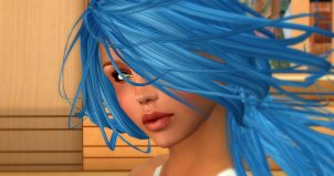 Close-up color photo of Fiona Blaylock in blue hair at Exile Hair Salon