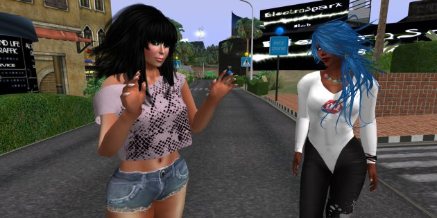 Photo of Anndy Believe & Vaneeesa Blaylock standing in the street at Circuit La Course on the Second Life Mainland