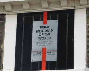 "Photo of ""The Prime Meridian,"" a red line painted on the door at the Greenwich Observatory"
